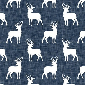 (small scale) bucks on navy linen