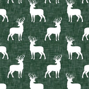 (small scale) bucks on green linen