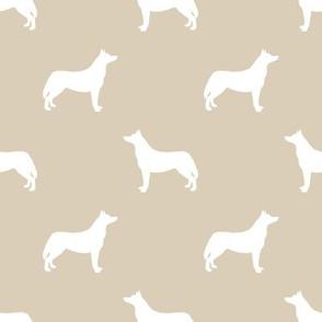 Husky dog silhouette sand