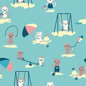 Tiny cats at the beach
