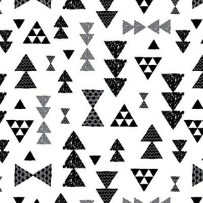 Geometric gender neutral bow tie and triangle tribal illustration pattern for boys or home decor Black and white