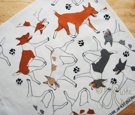 Trotting Rat terriers and paw prints - white