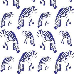 Zebras in royal blue on white