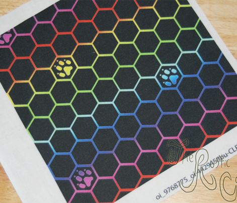 Canine paw prints on hexagons - rainbow dog paws