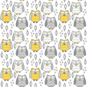 small gold and grey sleeping owls