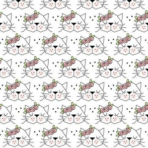small kitty faces with rosebuds on white