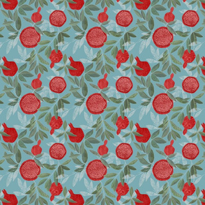 Red pomegranates on sky blue