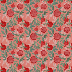 Red pomegranates on peach pink