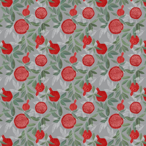 Red pomegranates on grey