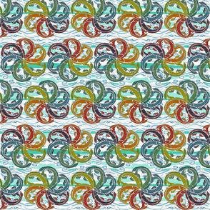 Multicoloured Fish Swirl on the Sea