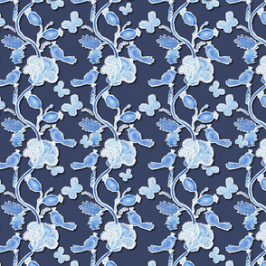 Paper cut blue birds and flowers on dark blue