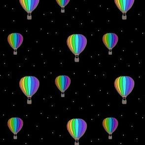 Rainbow hot air balloons at night