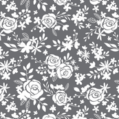 Dark grey background with white flowers and branches