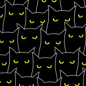 A clowder of cats-yellow eyes