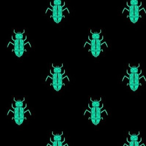Glowing Green Beetles