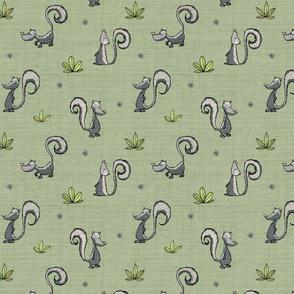 Skunks on knit - green
