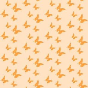 Small butterflies, coral orange on very light orange