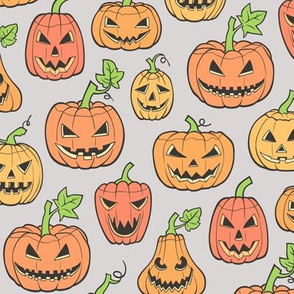 Halloween Jack-O-Lantern Scary Pumpkin Fabric   Orange on Light Grey
