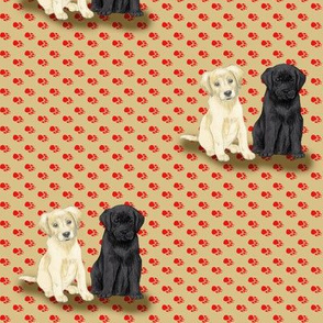 Two Sitting Labrador Retriever Puppies on Red Pawprints