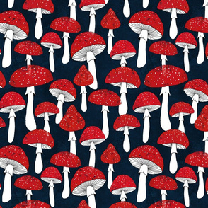 Red mushrooms on navy blue