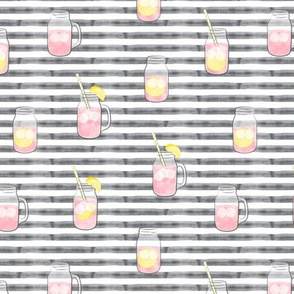 pink lemonade w/ straws - summer time drinks on grey stripes