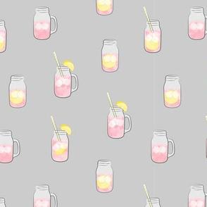 pink lemonade w/ straws - summer time drinks on grey