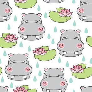 grey hippos and water lilies