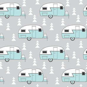 small teal vintage trailer on grey