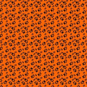 paw prints black on orange