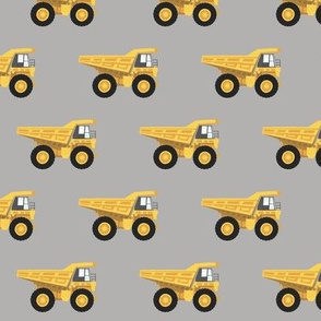 dump trucks - yellow on grey