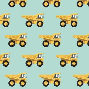 dump trucks - yellow on dark mint