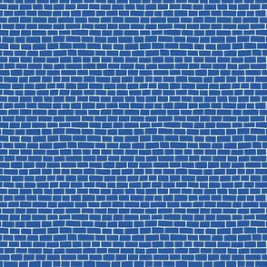 Bricks on solid evening blue