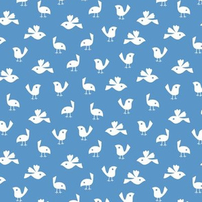 Pigeons on solid sky blue