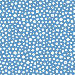Dots on solid sky blue