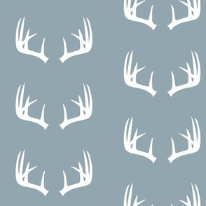 antlers on rustic wood blue
