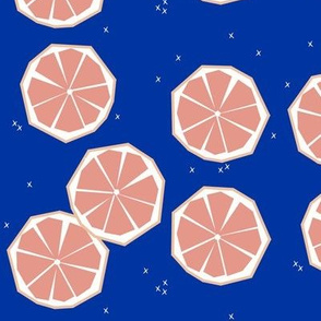 Grapefruit slices - pink grapefruit on cobalt blue tropical fruit