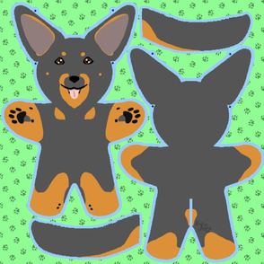 Kawaii Beauceron plushie on green - black and rust