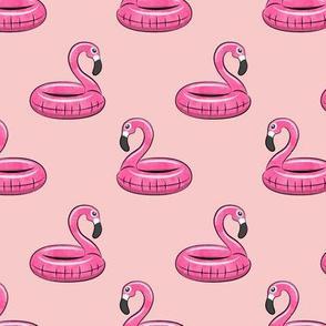 flamingo float on pink