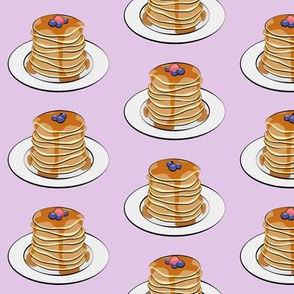 pancakes with berries on light purple