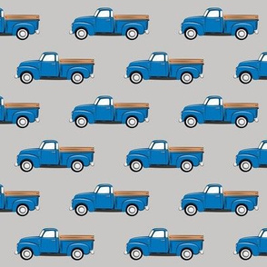 vintage blue truck on grey