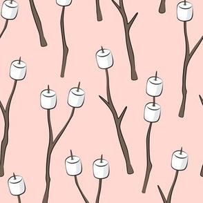 roasting marshmallows on light pink
