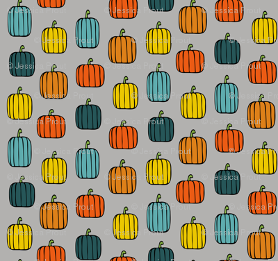 multi pumpkins on grey