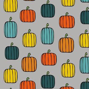 multi pumpkins on grey