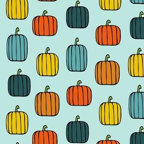 multi pumpkins on blue