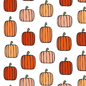 orange pumpkins on white