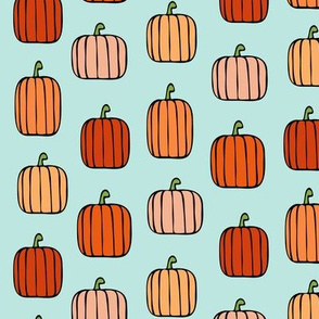 orange pumpkins on blue