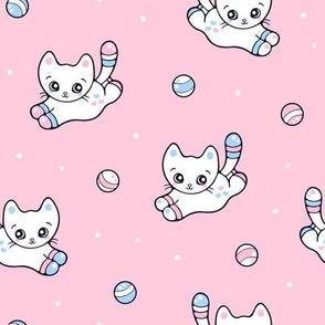 Cute Kitten chasing after a ball