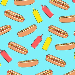 hot dogs on blue with condiments