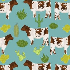 shorthorn cattle fabric cow and cactus design - blue