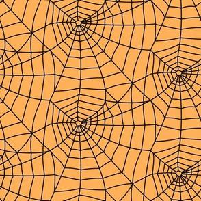spider webs - black on orange - halloween fabric